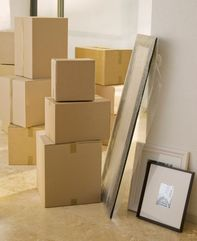 A stack of boxes and frames